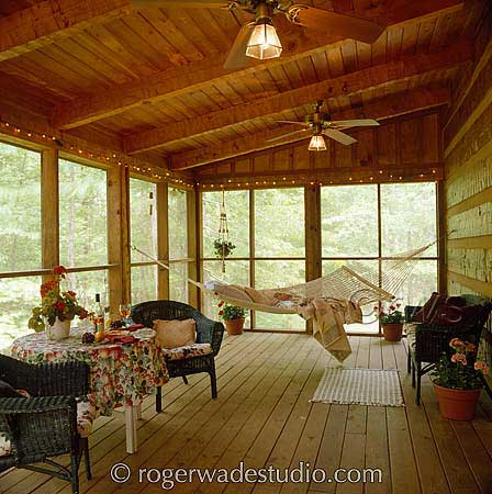 enclosed porch on log home with hammock