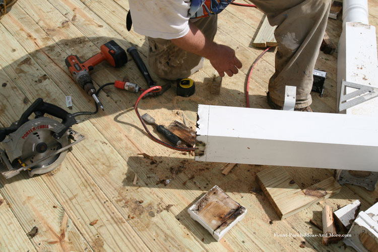 marking and cutting rotted porch column
