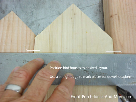 marking dowel locations using a straightedge to align and mark pieces of wood