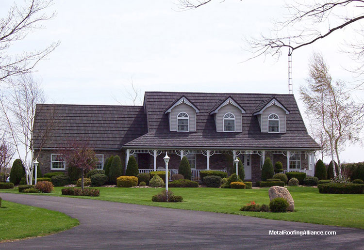 Metal roof on lovely gray cape cod home
