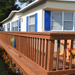 bright blue window shutters on mobile home