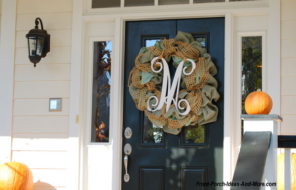 monogram burlap fall wreath on front porch of porch