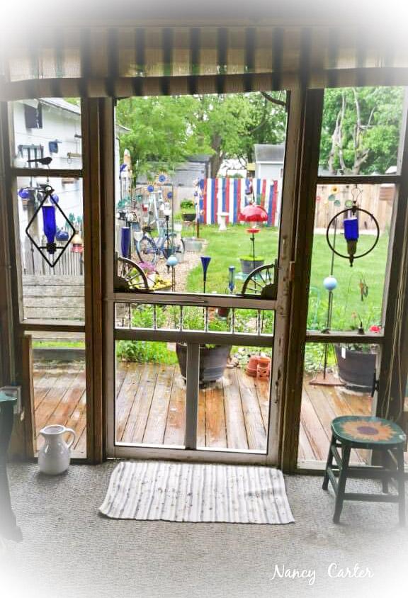 Nancy's friendly back porc - vintage screen door
