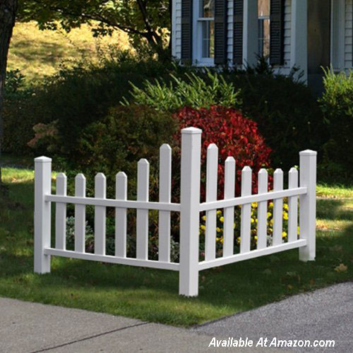 corner picket fence amongst flower gardens
