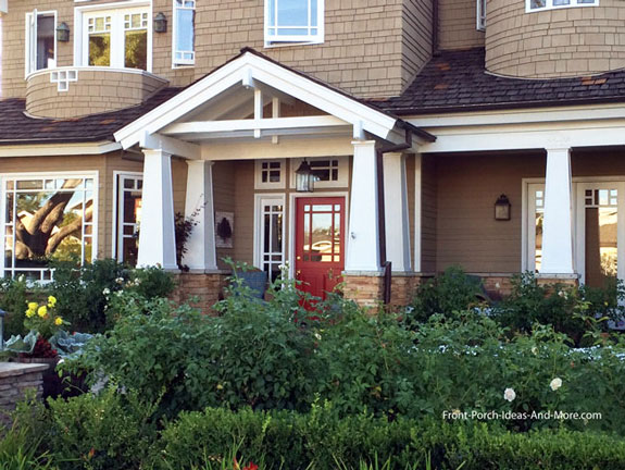 A contemporary front porch with craftsman columns and open gable roof