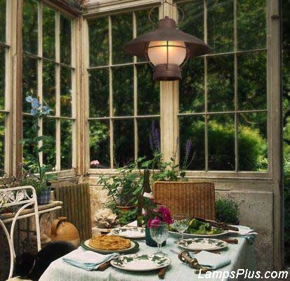 Sunroom furnished with chandelier and bistro table