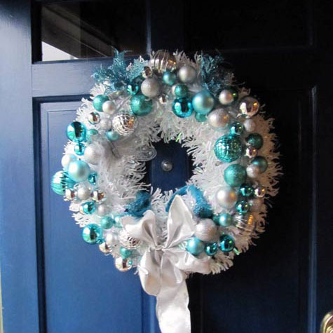 white and blue christmas wreath on front door