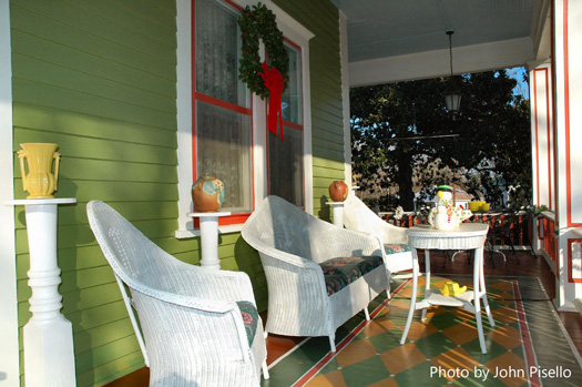 White wicker furniture complements christmas wreaths