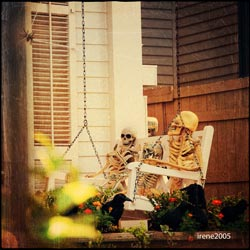 skeletons on front porch swing
