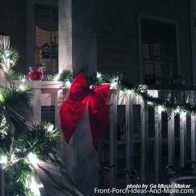 porch railing decorated for christmas
