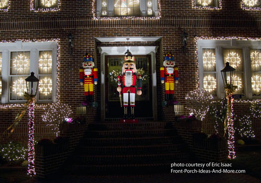 Nutcrackers standing guard on Christmas porch