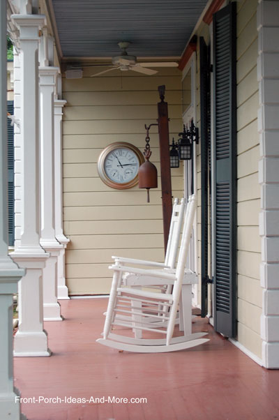 large outdoor thermometer clock on front porch wall
