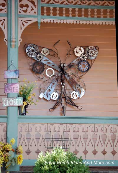butterfly wall art on porch