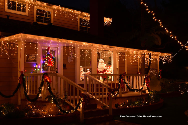 Santa in window with beautiful outdoor Christmas light on home