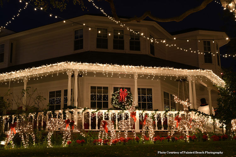 farmhouse porch with beautiful christmas lights