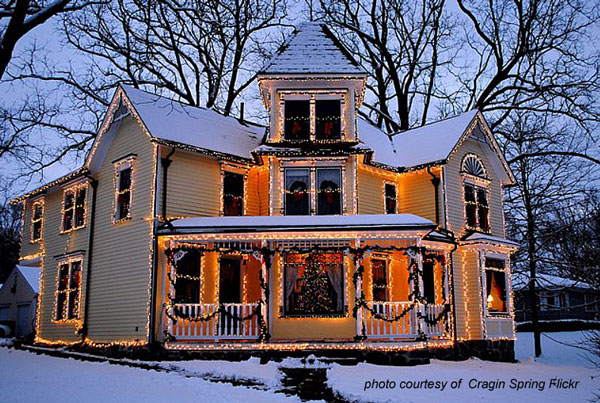 Victorian home outlined in Christmas lights