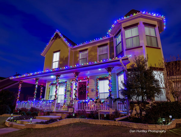 multi-light strings on two story home for Christmas