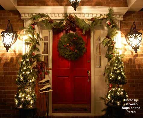 Susan's outside Christmas decorations - front porch decorated in red and green