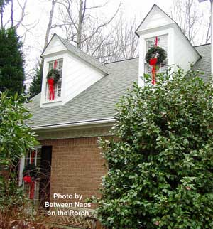 christmas wreath decorations using fresh greenery and plaid bow adorn the gas lantern