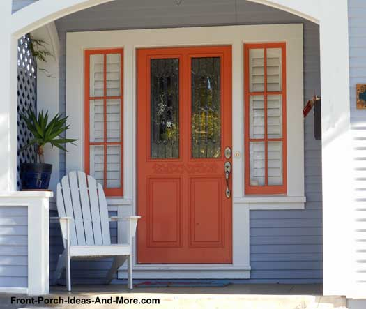 Orange front door and privacy partition on front porch