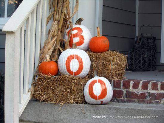 Pumpkins Painted White And Stencilled With Boo
