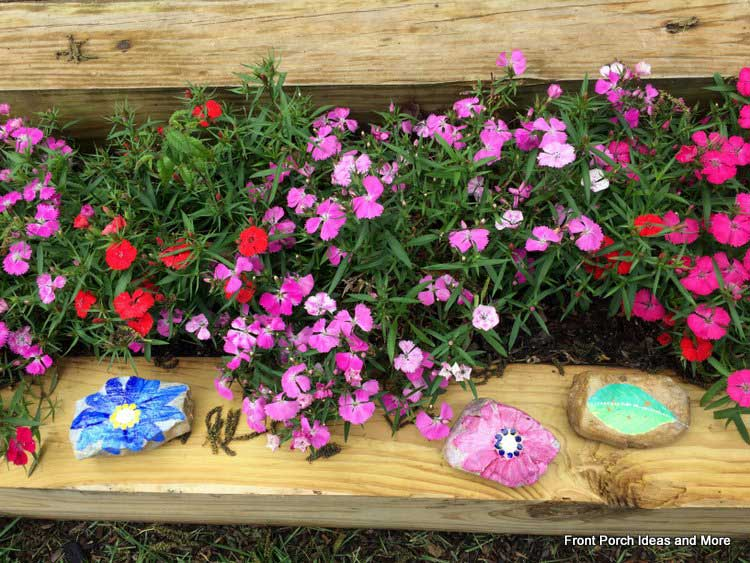 DIY painted rocks in the garden are a nice idea for someone you love