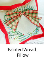 painted wreath on porch pillow