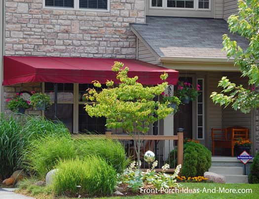 patio extension landscaped with awning