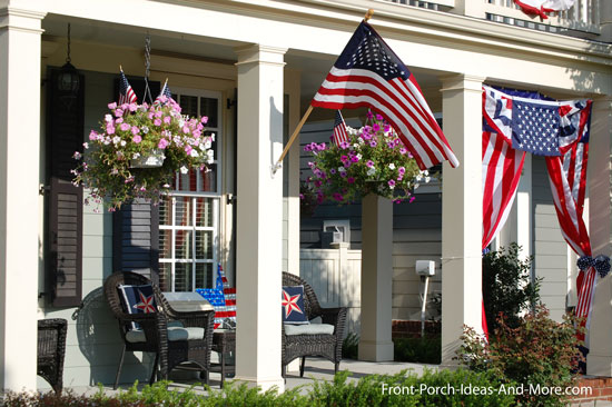 4th of july decorated front porch with hanging baskets