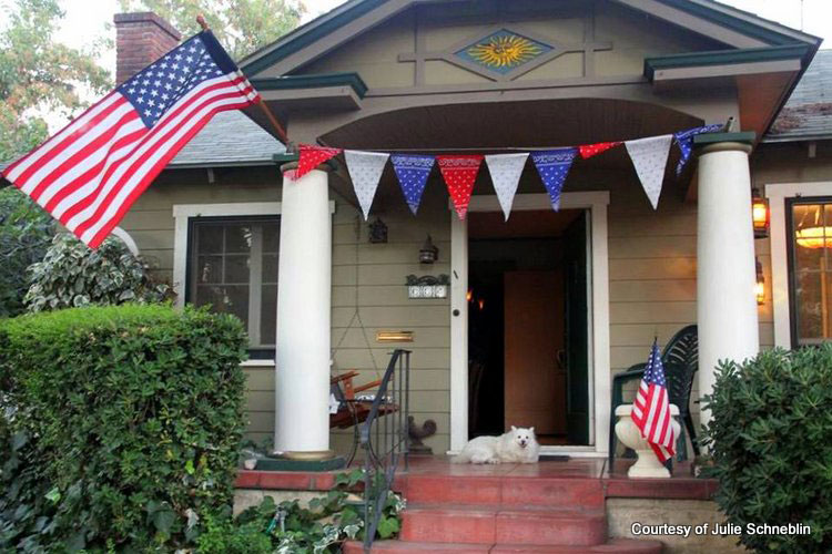 Julie's patriotic porch with US flag and banner
