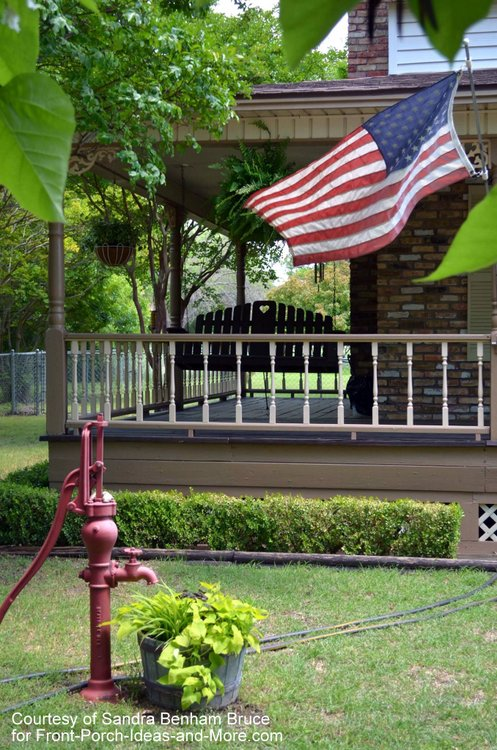 Sandra's beautiful porch and patriotic flag flying
