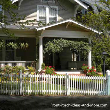 picket fence in front of wonderful front porch