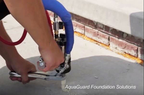 Concrete leveling with PolyLevel by AquaGuard Foundation Solutions)