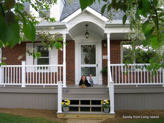 Sandy's new porch in Long Island - after - beautifully painted porch skirting
