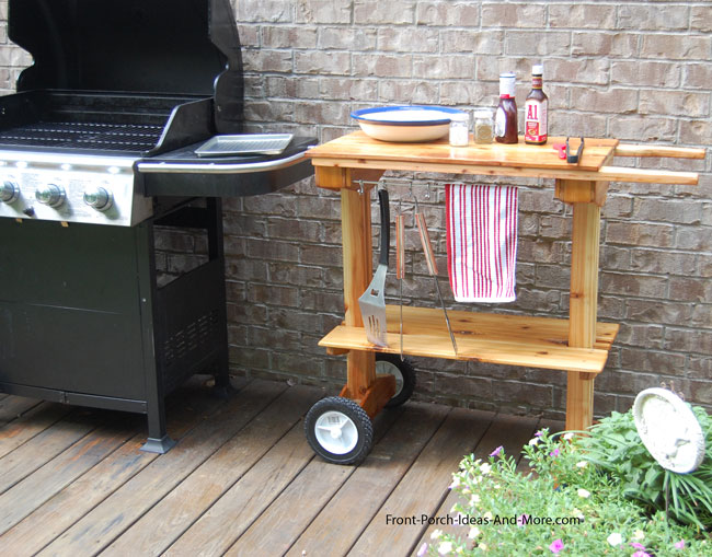 grill cart beside outdoor grill