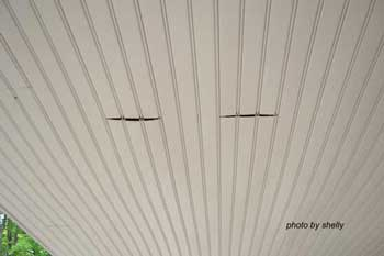 Close up of porch ceiling with open butt joints