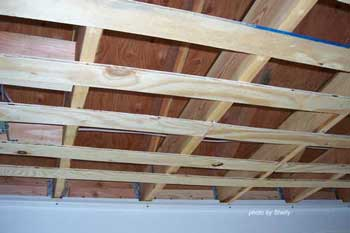Ceiling of porch with plywood furring strips
