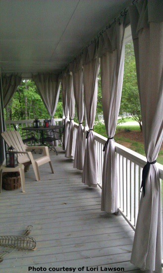 wraparound porch made even nicer with homemade outdoor curtain panels
