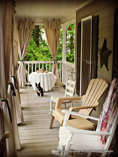 Beautiful view of the outdoor curtains on Lori's rocking chair porch