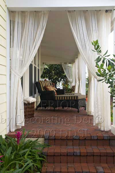 Sheer porch curtains on expansive front porch