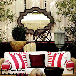 front porch decorated with mirror over furniture