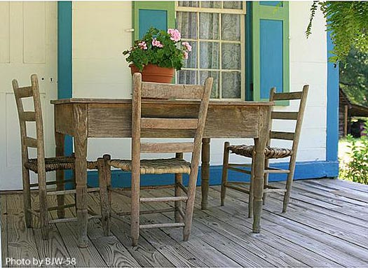 Porch decorating - table and chairs are simply beautiful