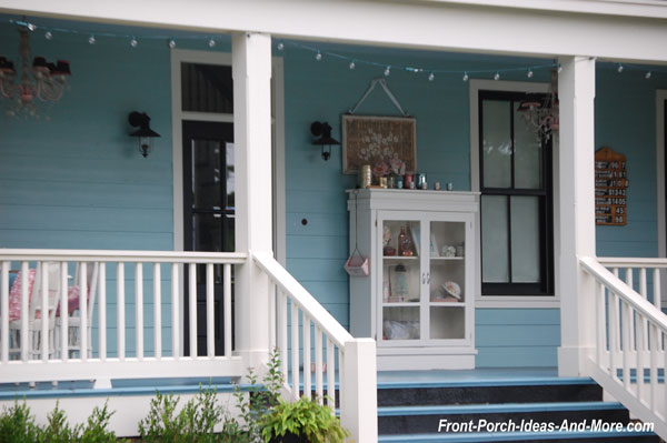 white display cabinet on front porch