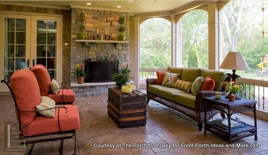 One of The Porch Company's beautiful custom screened porches with a fireplace