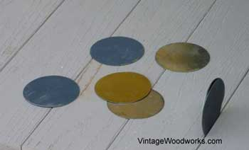 Because porch floor wasn't square, they used disks as spacers to correct the problem