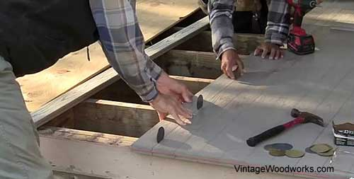 Keep measuring as you go along with installing the porch boards to be sure you stay square