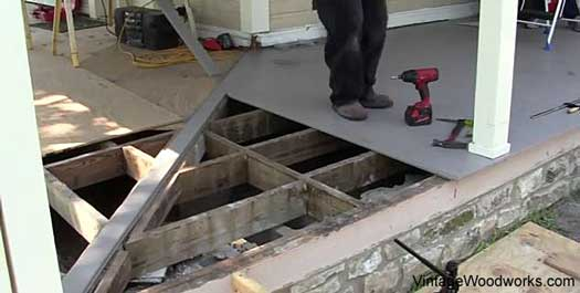 tongue and groove porch floor installation - nearing the corner