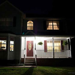 front porch and home lit up at night