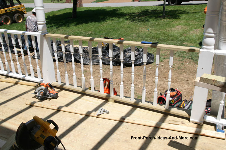 porch railings being installed on new front porch remodel