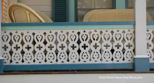 sawn pickets in lovely Celtic-like pattern with two-tone railings